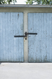 Germany, Duesseldorf, two old locked garage doors - VIF000393