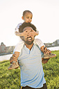 Germany, Cologne, father carrying his son on shoulders - MADF000648