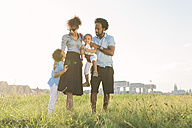 Germany, Cologne, family of four in a field - MADF000651