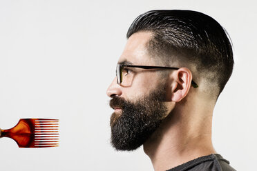 Profile of a hipster in front of white background - JASF000023