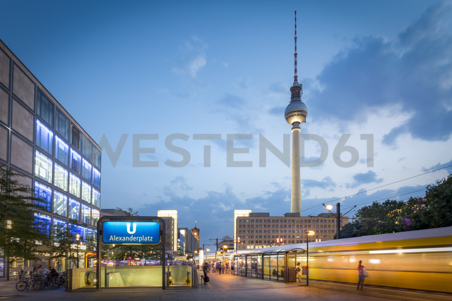 Germany, Berlin, view to television tower and tram stop in the foreground at twilight - NK000395