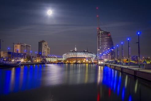 Germany, Bremerhaven, Klimahaus and Atlantic Hotel Sail City at night - NKF000380