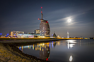 Germany, Bremerhaven, Klimahaus and Atlantic Hotel Sail City at night - NKF000383