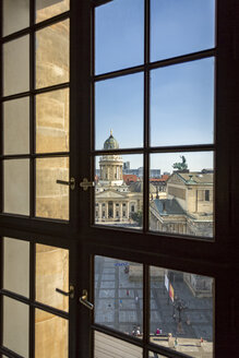 Germany, Berlin, look through window to Gendarmenmarkt from French Cathedral - NKF000386