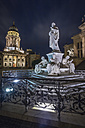 Germany, Berlin, Schiller monument at Gendarmenmarkt with German Cathedral in the background at night - NKF000398
