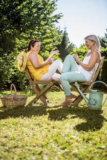 Happy mature women in garden - RKNF000303