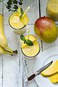 Two glasses of mango banana smoothie - ODF001240