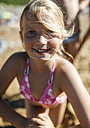 Portrait of a smiling little girl on the beach - MGOF000586