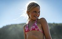Portrait of a blond little girl wearing bikini top - MGOF000590