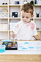 Portrait of little boy painting with watercolours - JRFF000029
