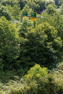 Germany, Duesseldorf, view to road signs in between trees - VIF000390