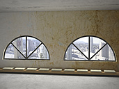Row of cushions on wooden bench under two round arch windows, 3D Rendering - UWF000609