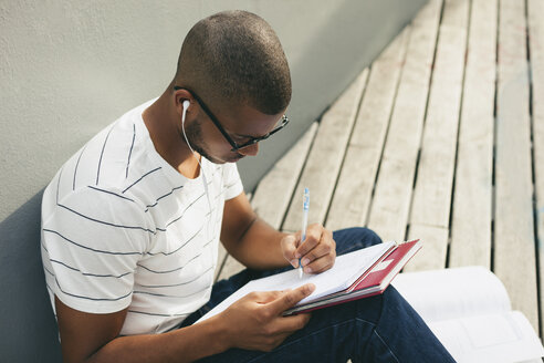 Young Afro-american man studying language - EBSF000867