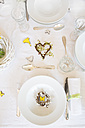 Place setting on laid table at springtime - LVF003768