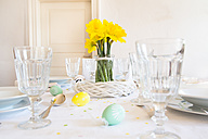 Laid Easter table with bunch of daffodils - LVF003774