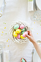 Little girl decorating dining table with Easter eggs - LVF003781