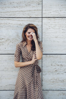 Portrait of laughing brunette woman outdoors - CHAF001399