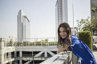 Germany, Frankfurt, portrait of smiling businesswoman - RIBF000285
