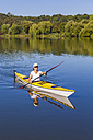 Germany, Stuttgart, woman kayaking on Max-Eyth-See - WDF003249