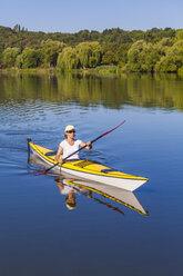 Germany, Stuttgart, woman kayaking on Max-Eyth-See - WDF003249
