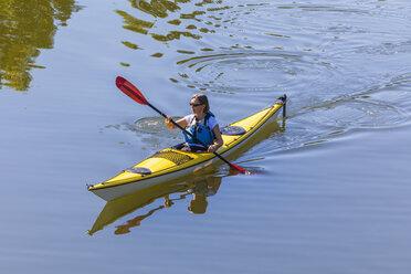Germany, woman kayaking - WDF003256