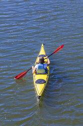 Germany, woman kayaking - WDF003258