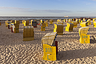 Germany, Lower Saxony, Cuxhaven, beach with beach chairs in evening light - WIF002617