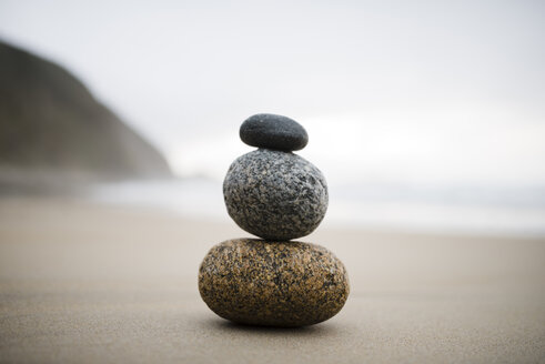 Spain, three rocks balanced on the beach - RAEF000450