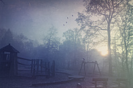 Playground in misty fall morning, textured effect - DWIF000594