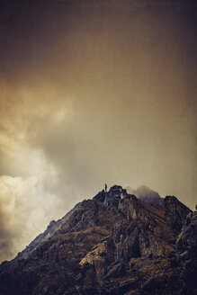 Silhouette of a man on mountain top, clouds - DWIF000591