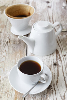 Cup of black filtered coffee and coffee pot on wood - EVGF002168