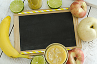 Fruits, glass of fruit smoothie and blank chalkboard on wood - ODF001262