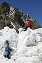 Italy, Alto Adige, two children playing in the snow - TMF000033
