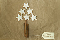 Christmas tree built of cinnamon stars and sticks on packing paper - ODF001285