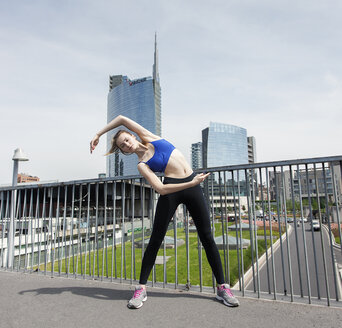 Young woman doing workout in the city - PASF000023