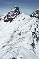 Austria, Tyrol, Ischgl, avalanche protection in winter landscape in the mountains - ABF000662