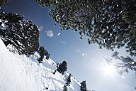 Austria, Tyrol, Ischgl, winter landscape in the mountains in backlight - ABF000663