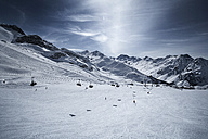 Austria, Tyrol, Ischgl, chair lift in winter landscape in the mountains - ABF000664