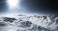 Austria, Tyrol, Ischgl, mountainscape in winter in backlight - ABF000642