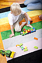 Little boy playing on the carpet of children's room - MFRF000413