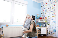 Mother and little son together at children's room - MFRF000458