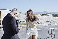 South Africa, Cape Town, photographer taking pictures of a model - RORF000127
