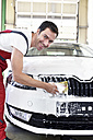Car cleaning, man cleaning car with sponge - LYF000479
