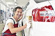 Car cleaning, man cleaning car - LYF000482