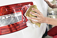 Car cleaning, man cleaning car, washing with sponge - LYF000484