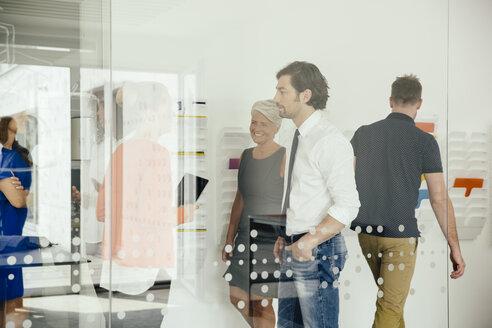 Employees in a modern office walking around - MFF002176