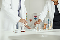 Two scientists working with liquids in lab - MFF002180
