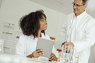 Two scientists with digital tablet in lab - MFF002186