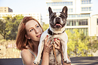 Redheaded woman with her dog - TAMF000301
