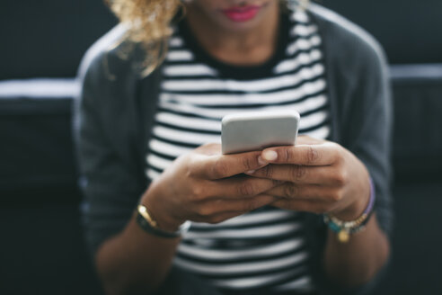 Woman's hands holding smartphone - EBSF000890